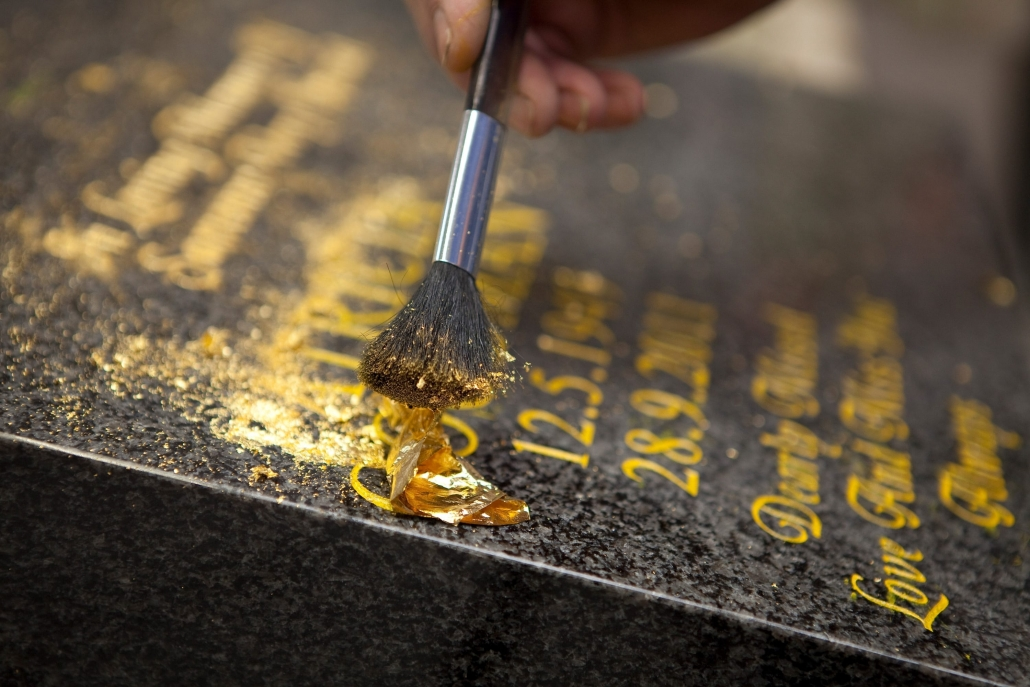 Gravestone inscribing with gold lettering
