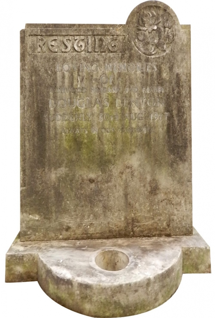 a dirty headstone before restoration
