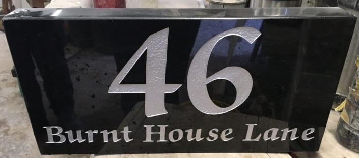 Black granite house place with no.46 in silver writing
