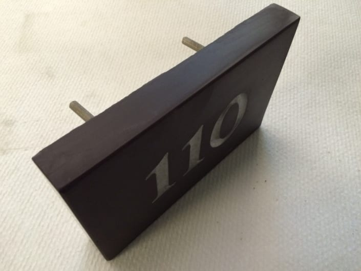 number 110 house plaque with silver lettering from the back view
