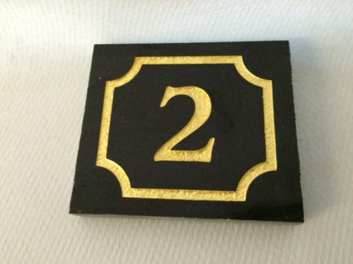 Black granite house plaque with no.2 in gold lettering